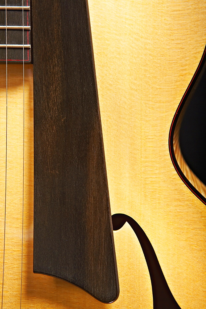 Close up of acoustic guitar saddle
