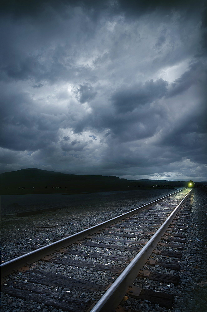 Train on railroad tracks at stormy day