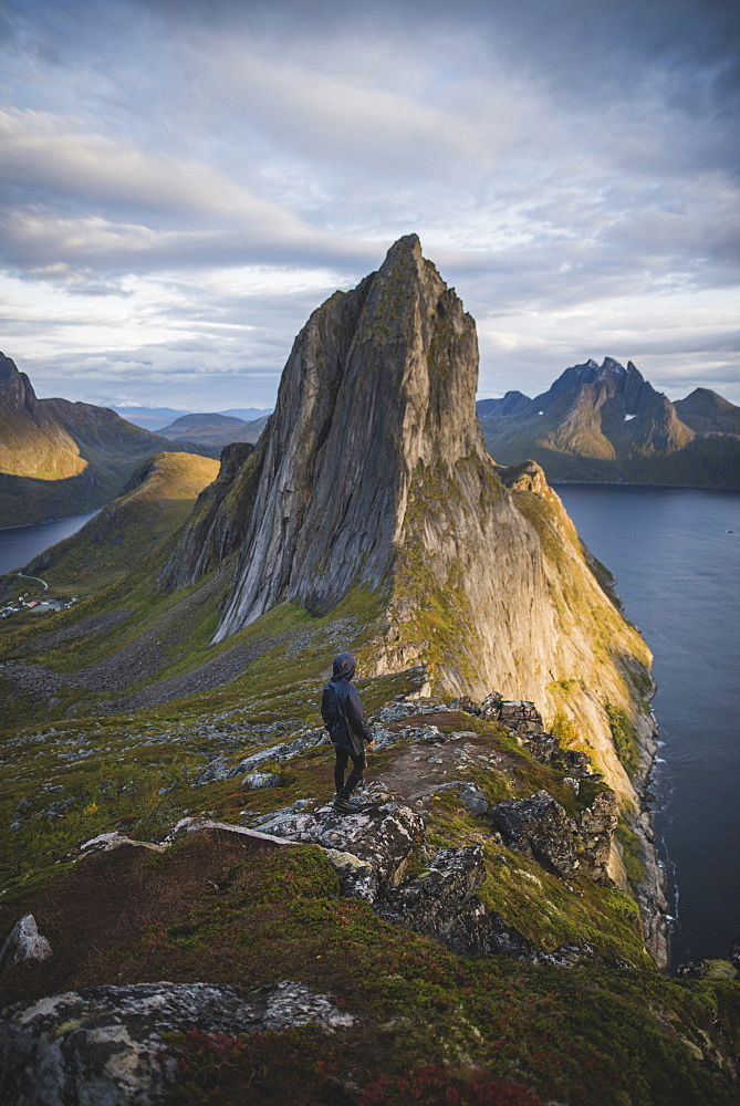 Norway, Senja, Man hiking near Segla mountain