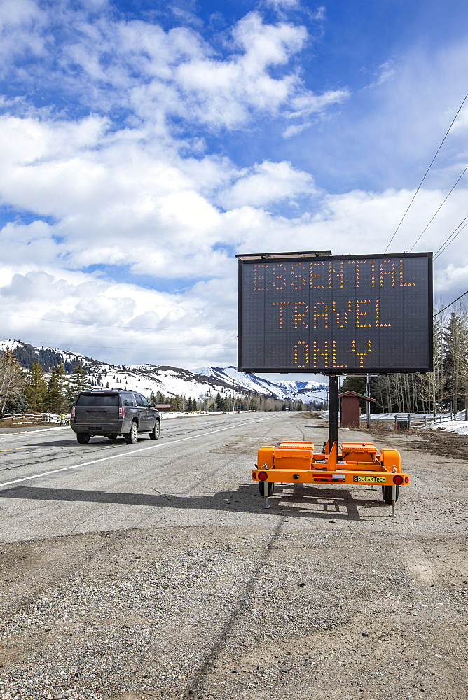 USA, Idaho, Sun Valley, COVID_19 lockdown on travel electronic sign on roadside
