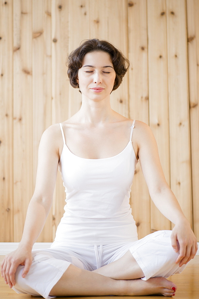 Woman meditating in spa