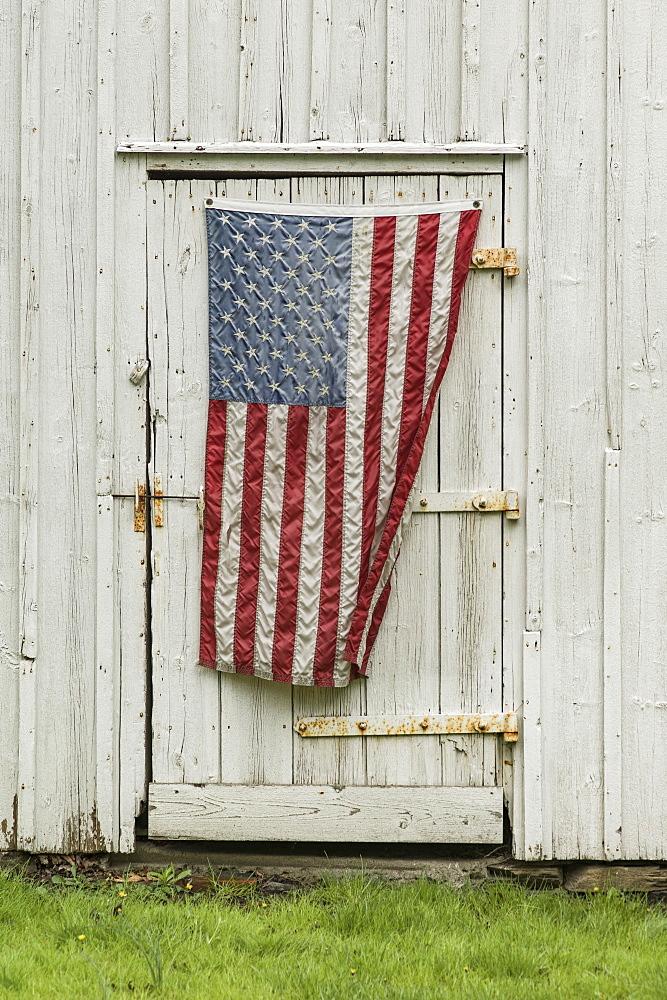 American flag hanging on barn door - 1178-30037