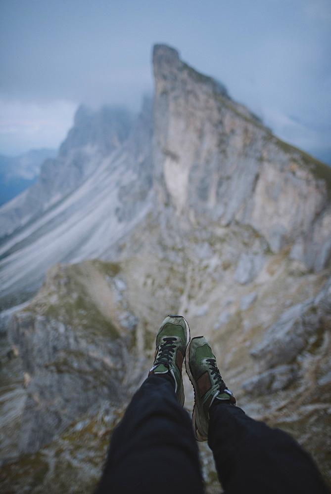 Italy, Dolomite Alps, Seceda mountain, Low section of man near Seceda mountain in Dolomites