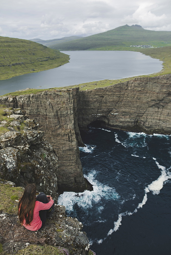 Denmark, Faroe Islands, Sorvagsvatn lake, Woman looking at dramatic landscape
