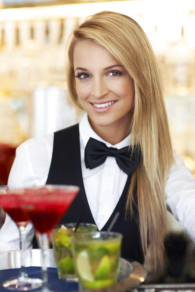Portrait of female bartender holding tray with cocktails - 1178-301