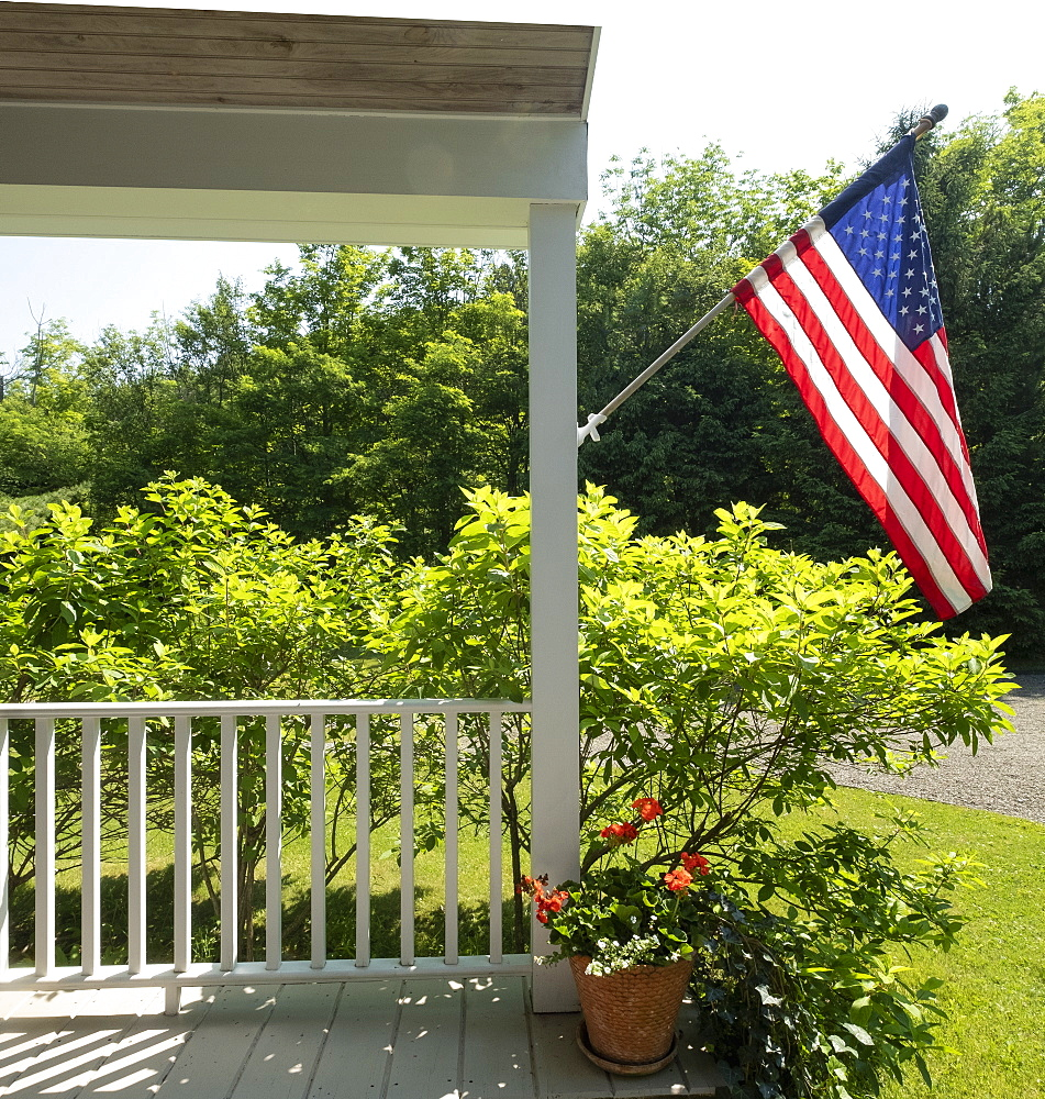 USA, US flag on porch - 1178-30127