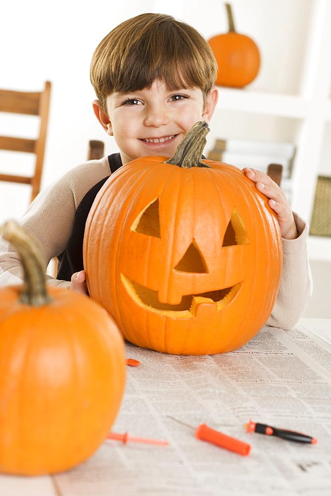 Young boy with a jack o lantern