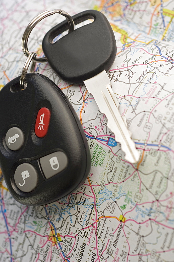 Closeup of car keys and map