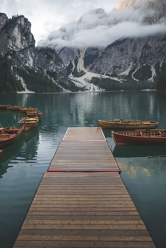 Italy, Pragser Wildsee, Dolomites, South Tyrol, Rowboats moored near jetty in mountain lake - 1178-30398