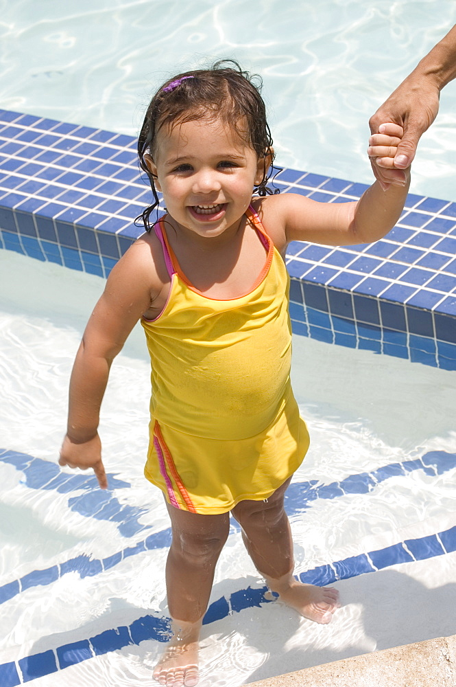 Girl standing in swimming pool