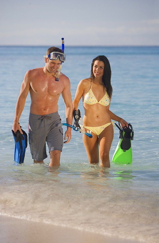 Couple using snorkeling gear