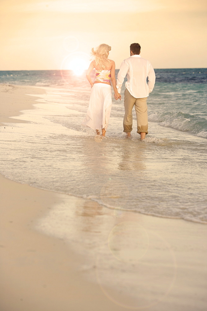 Couple strolling the beach