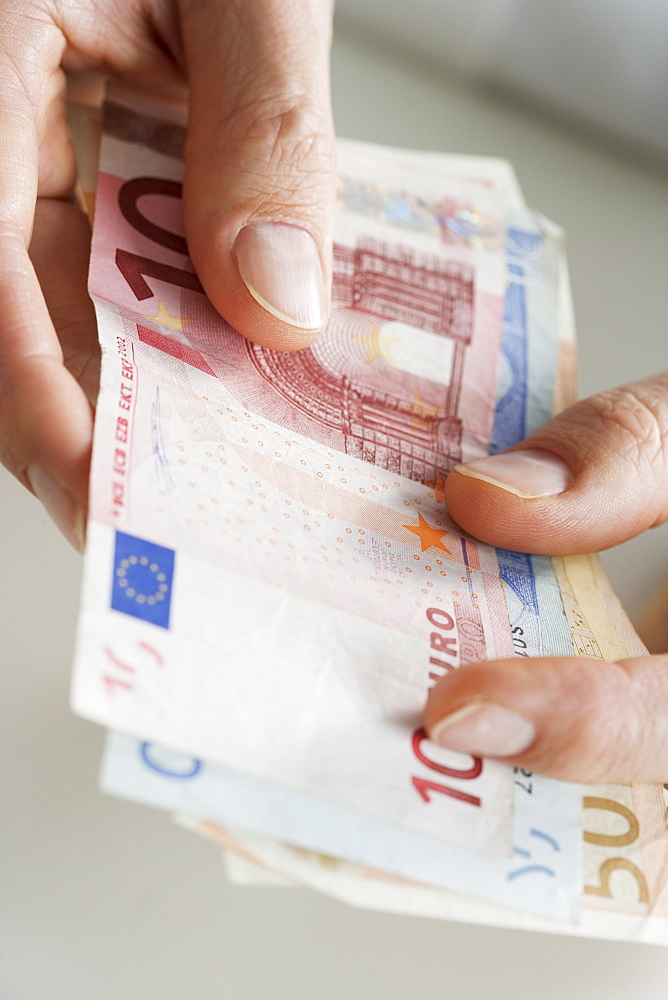 Closeup of hands with European money