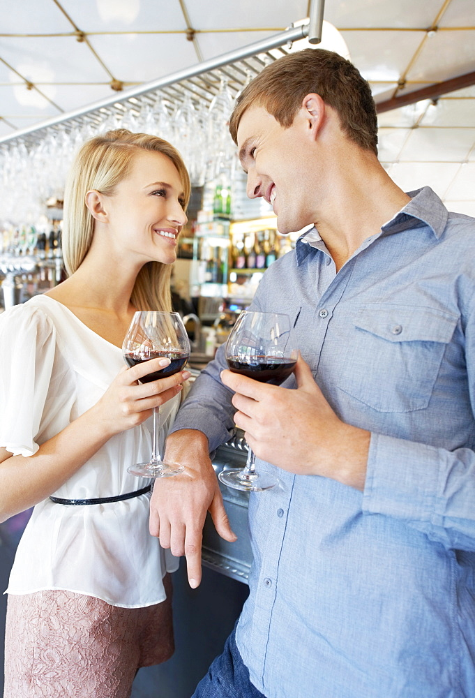 Couple drinking wine in bar