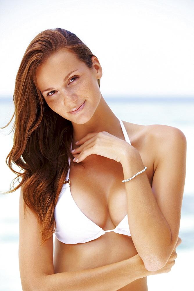 Portrait of young woman in bikini