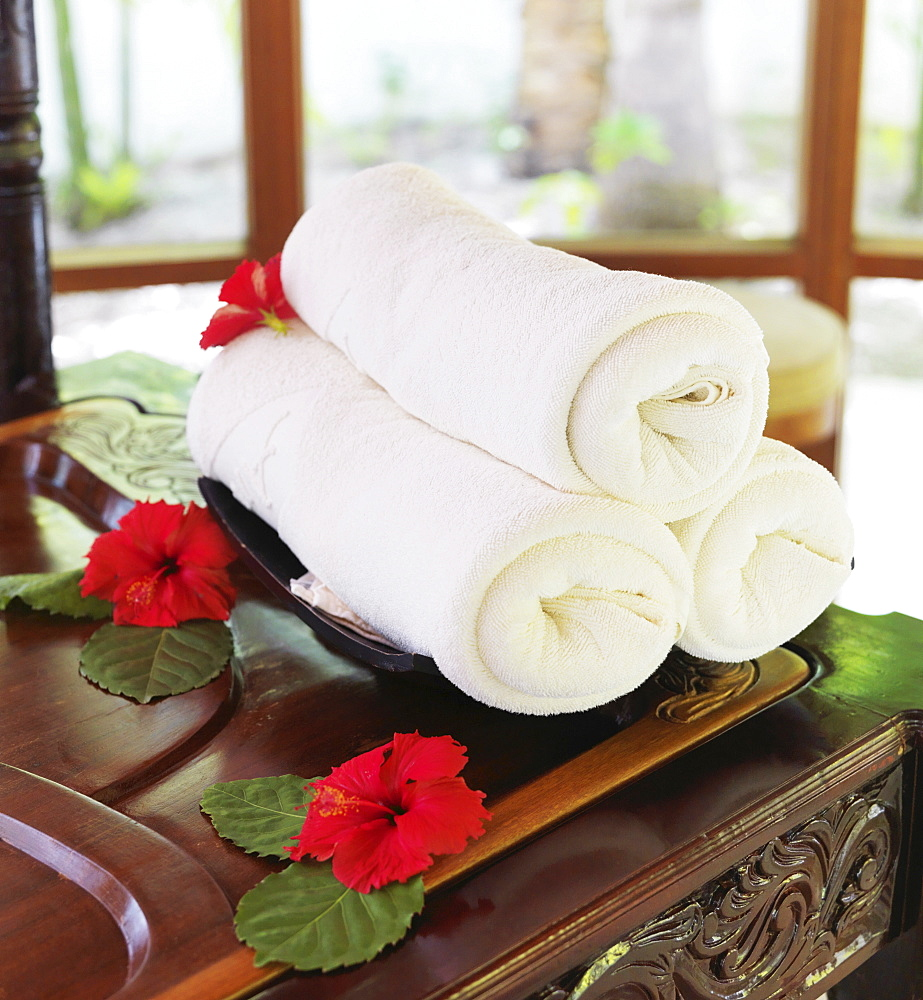Rolled up towels in spa