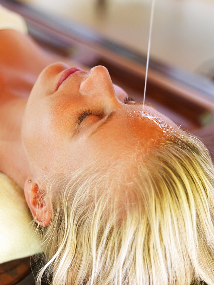 Woman getting aromatherapy in spa