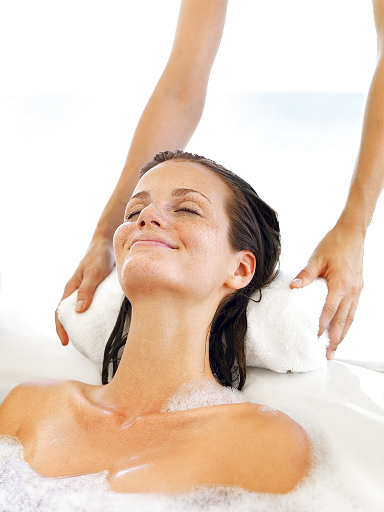 Woman receiving spa therapy