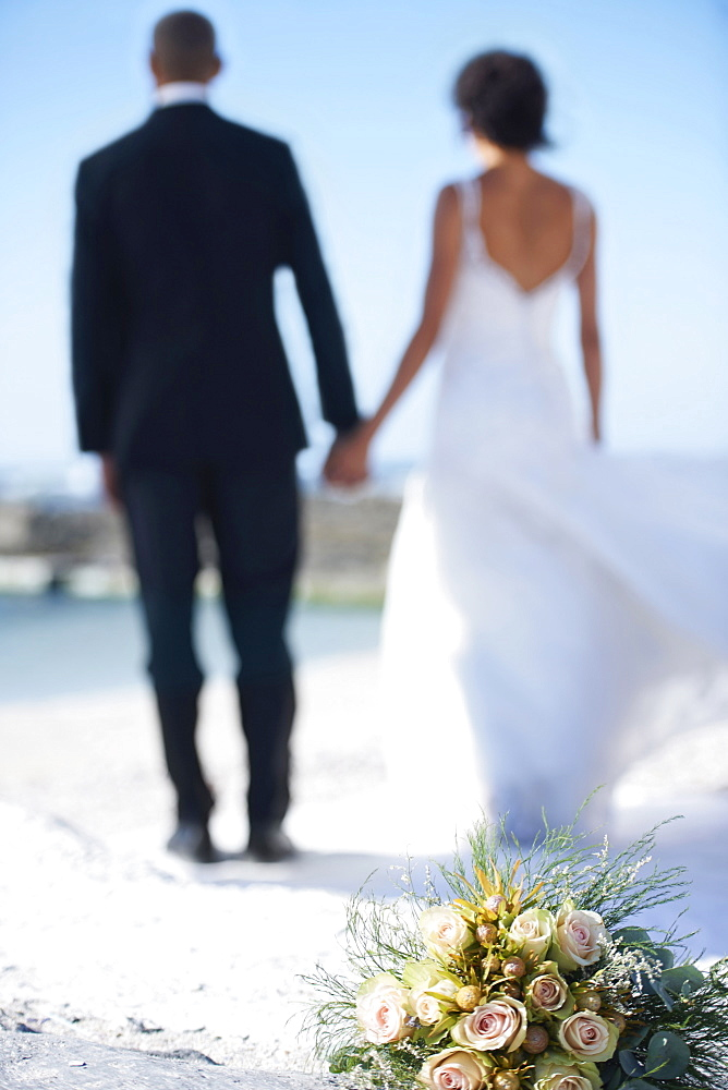 Newlywed couple on beach