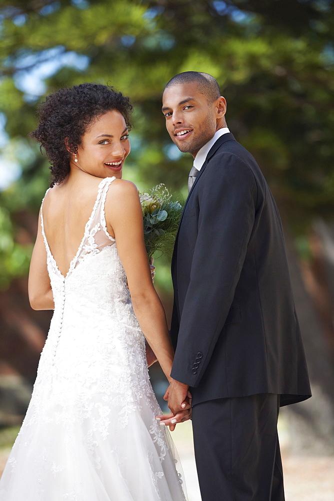 Portrait of newlywed couple