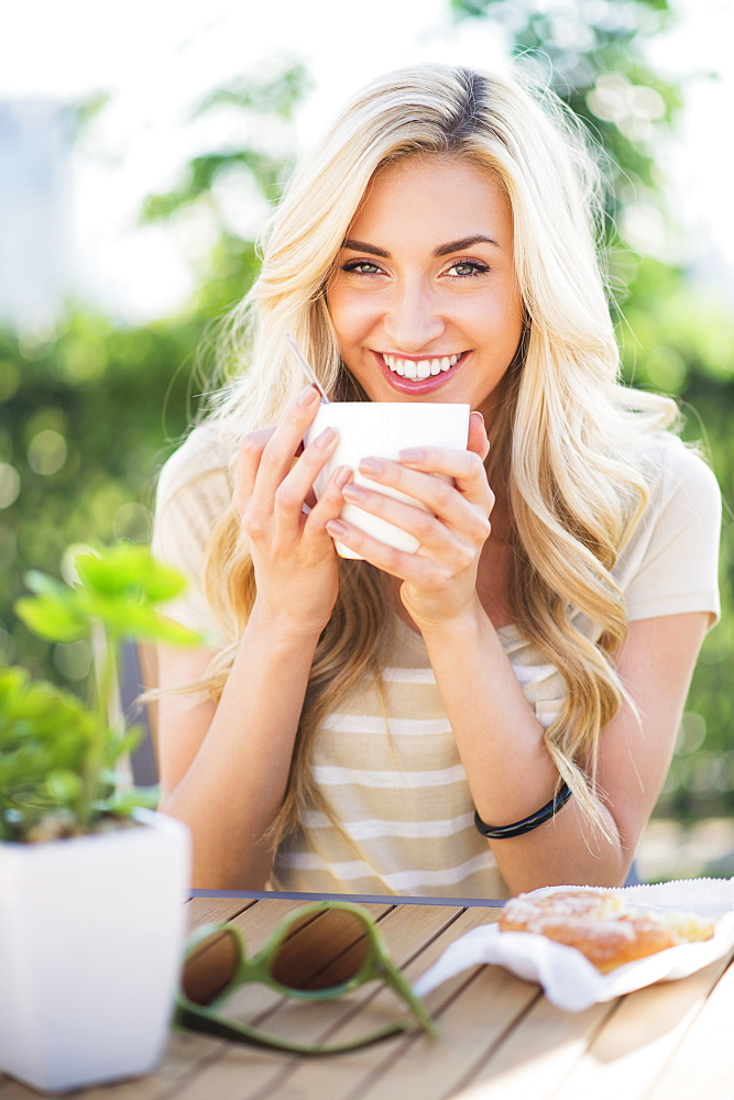 Portrait of teenage girl (16-17) drinking coffee