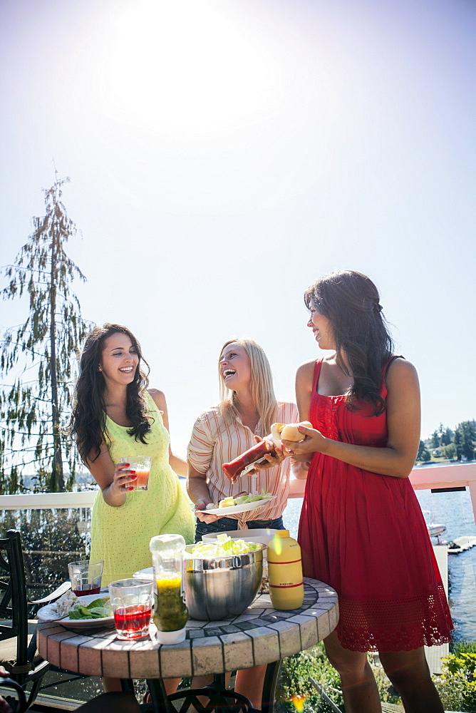Young women enjoying barbecue, USA, Washington, Bellingham