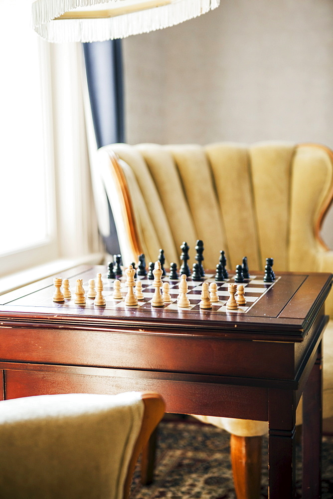 Empty room with armchairs and chess