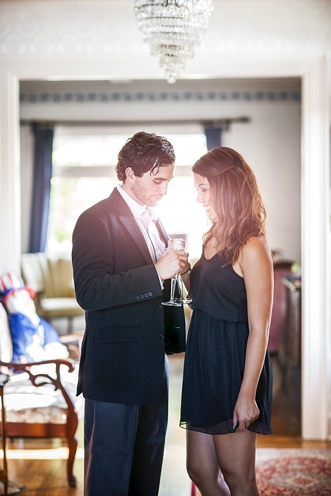 Young elegant couple drinking wine