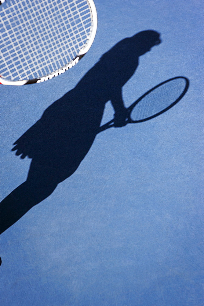 Shadow of female tennis player