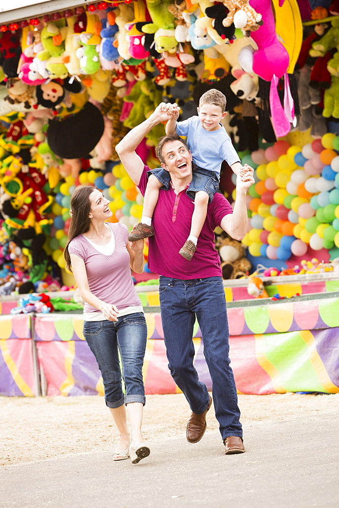 Happy Family with son (4-5) in amusement park, USA, Utah, Salt Lake City