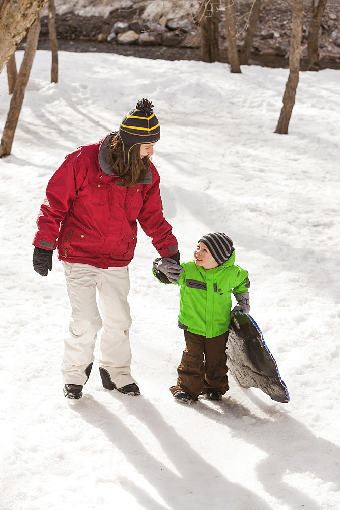 Portrait of young woman with boy (4-5) during stroll, USA, Utah, Highland