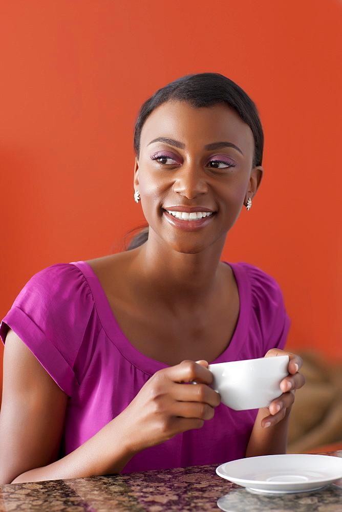 Young woman enjoying morning coffee