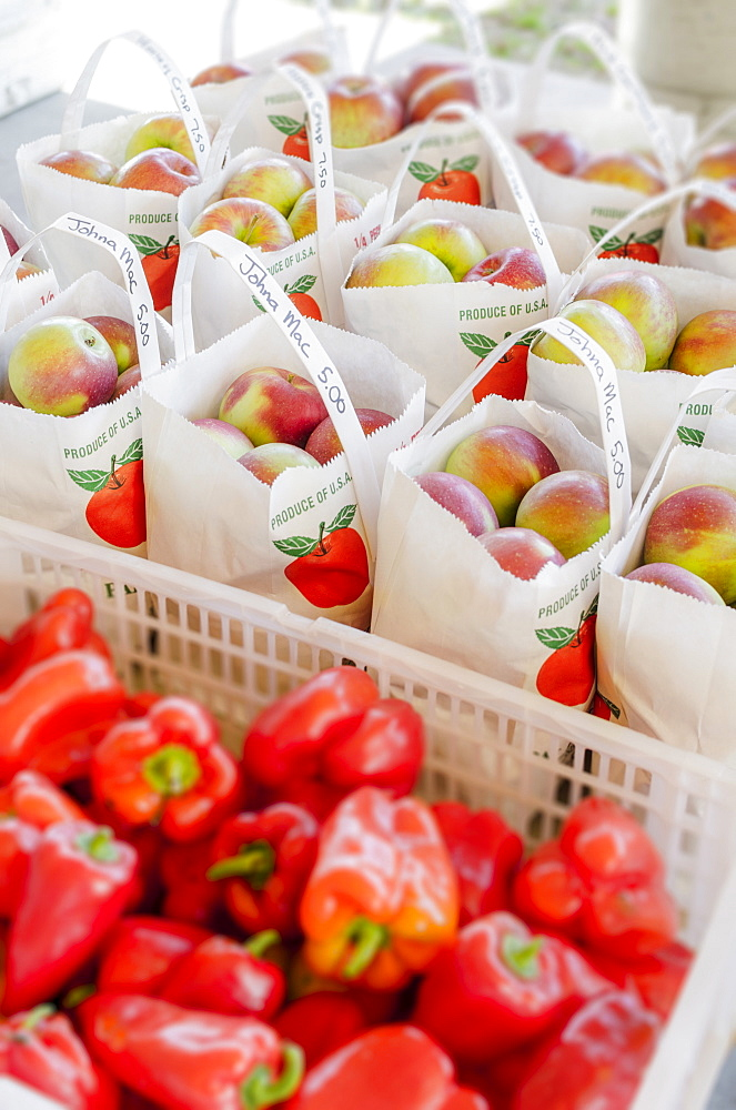 Apples and red peppers ready to be bought