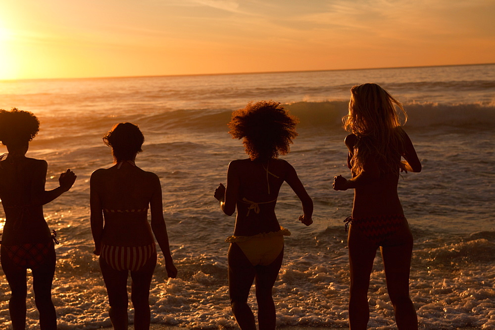 Four young women standing upright on the beach - 1120-1051