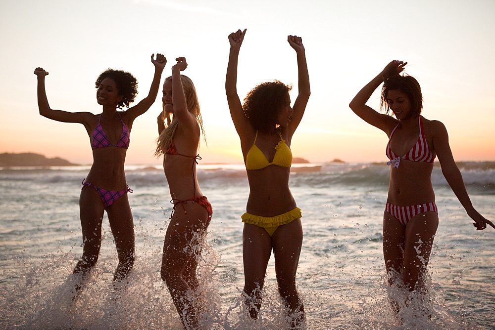 Young women showing their happiness at sunset - 1120-1069