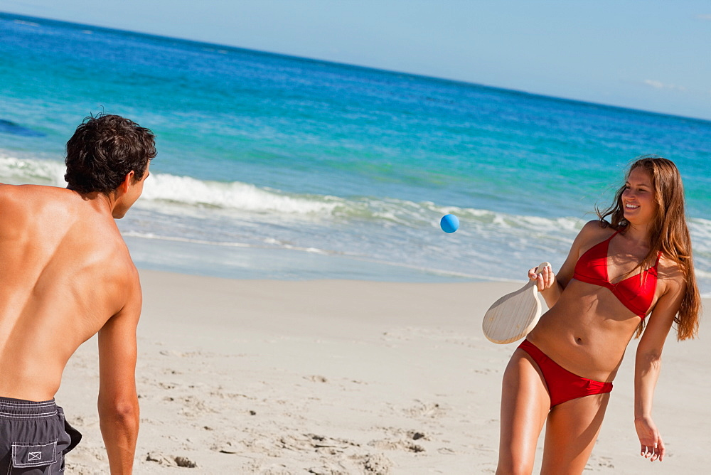 Close-up of a couple playing with beach racket  - 1120-1436