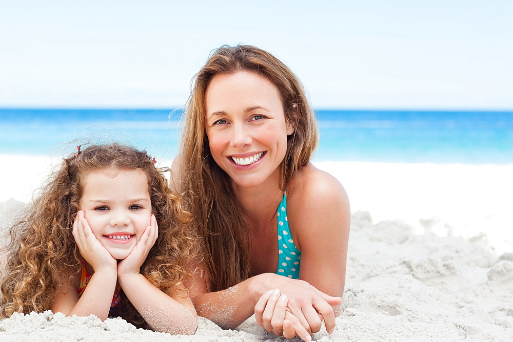 Mother and daughter lying on the beach - 1120-622