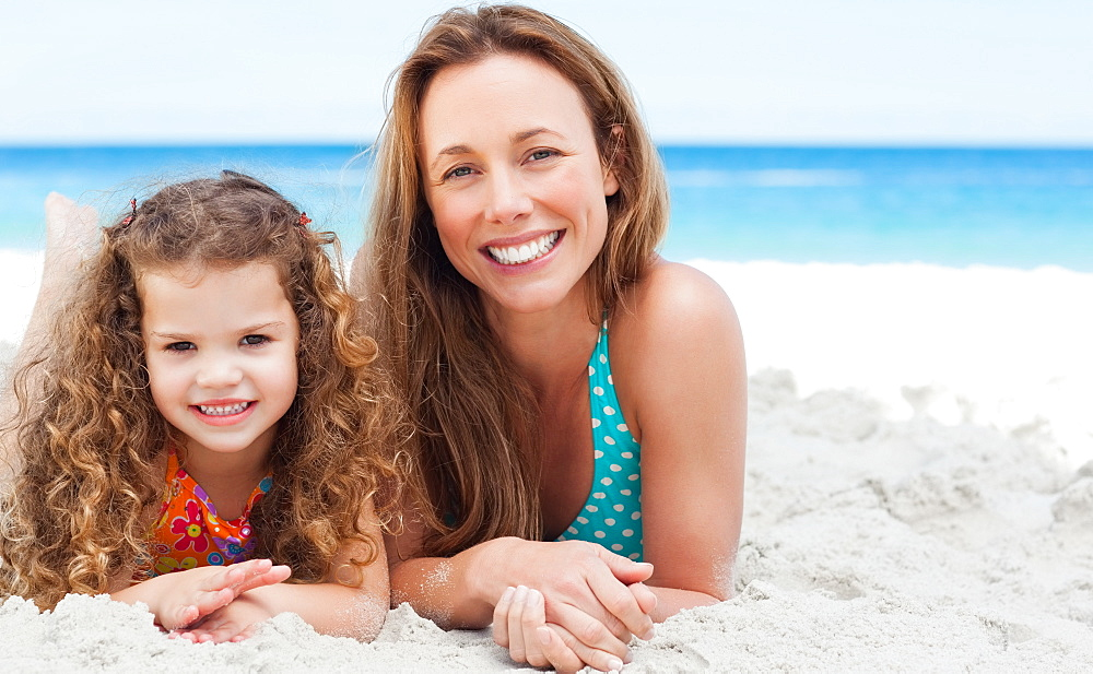 Mother and daughter lying on the beach together - 1120-623