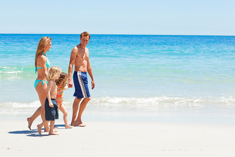 Side view of a family taking a walk at the beach - 1120-646