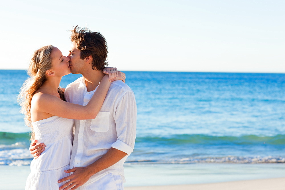 Couple kissing on the beach - 1120-785