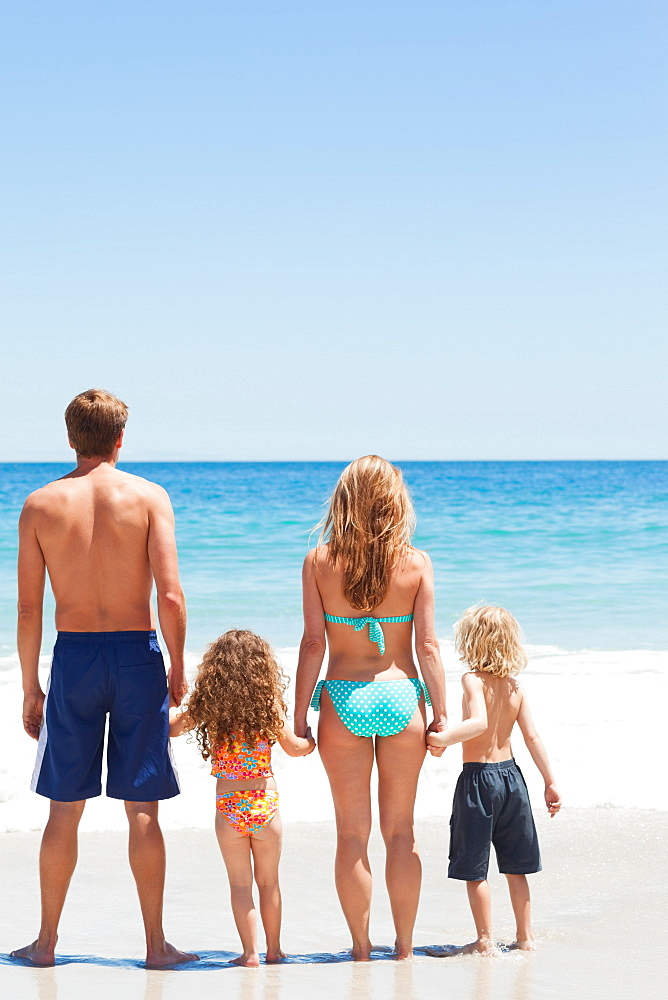 Family standing in front of the sea together - 1120-643