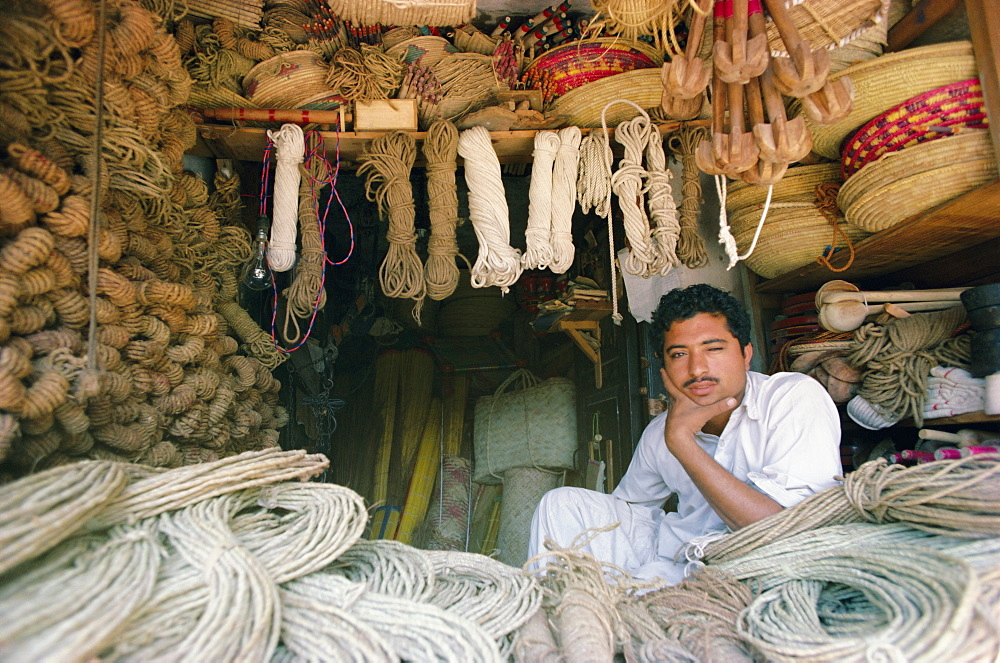 Stallholder selling rope, twine and baskets in the market, Karachi, Sind (Sindh), Pakistan, Asia