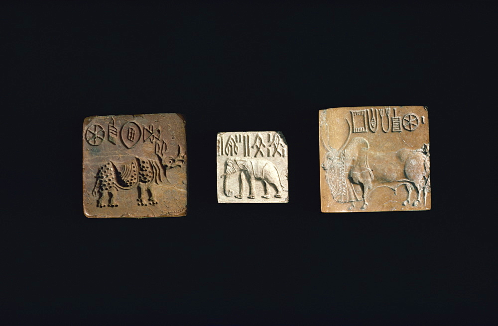 Seals depicting animals from the Indus civilisation of Mohenjodaro, in the Karachi Museum, Pakistan, Asia