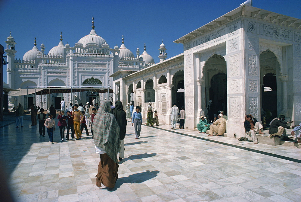 Groups of people at the Data Durbar Shrine in Lahore, Pakistan, Asia