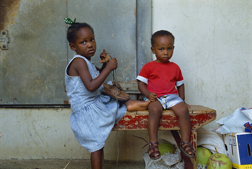 Portrait of two young children, Scarborough, Tobago, West Indies, Caribbean, Central America