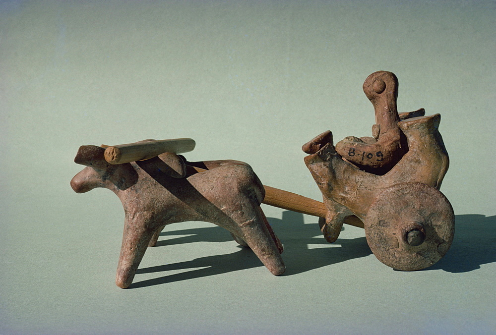 Figure in a chariot or cart drawn by animals, from the Indus civilisation at Mohenjodaro, in the Karachi Museum, Pakistan, Asia