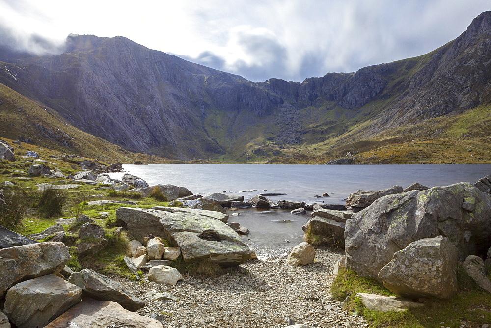 A small unnamed source in the Ogwen Valley (Dyffryn Ogwen) with the Glyderau mountain range behind, Gwynedd, Snowdonia National Park, Wales, United Kingdom, Europe
