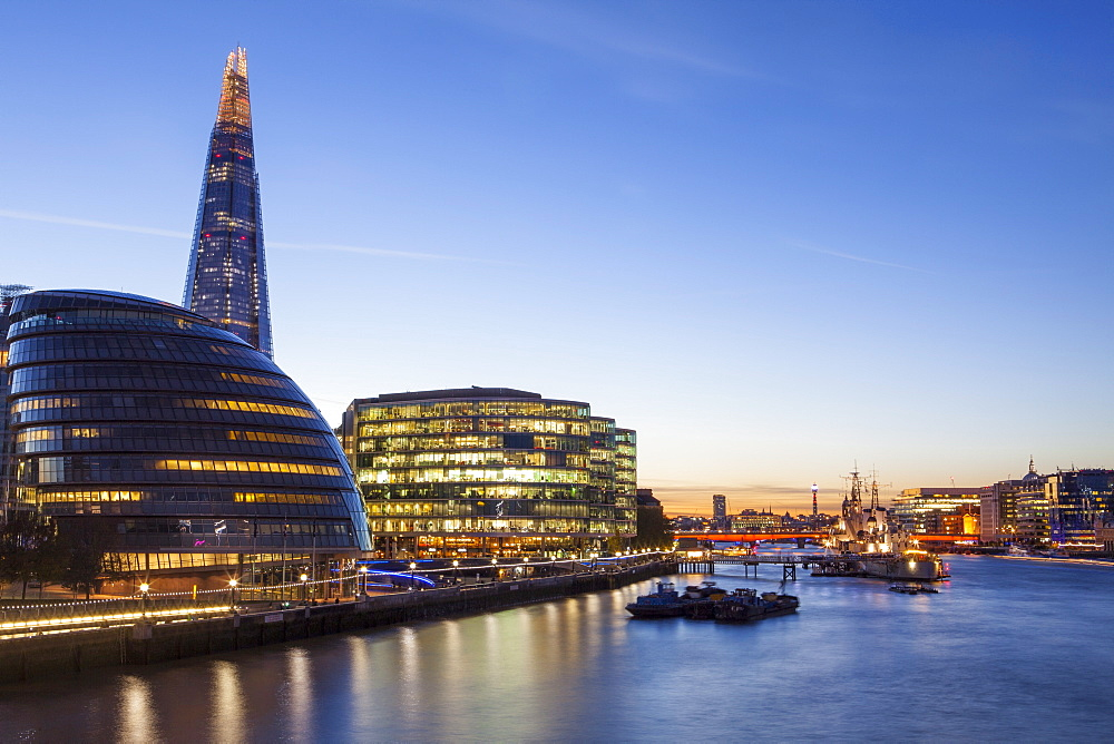 London skyline at dusk including the GLC building, HMS Belfast and the Shard, taken from Tower Bridge, London, England, United Kingdom, Europe