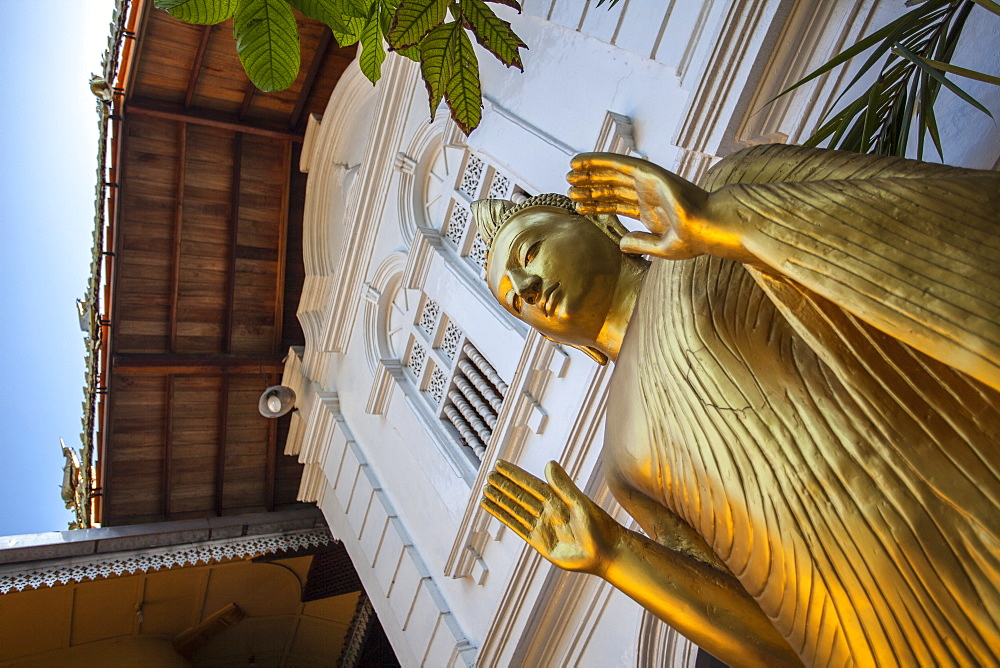 Golden statue at the entrance of Gangaramaya Temple, Colombo, Sri Lanka, Asia