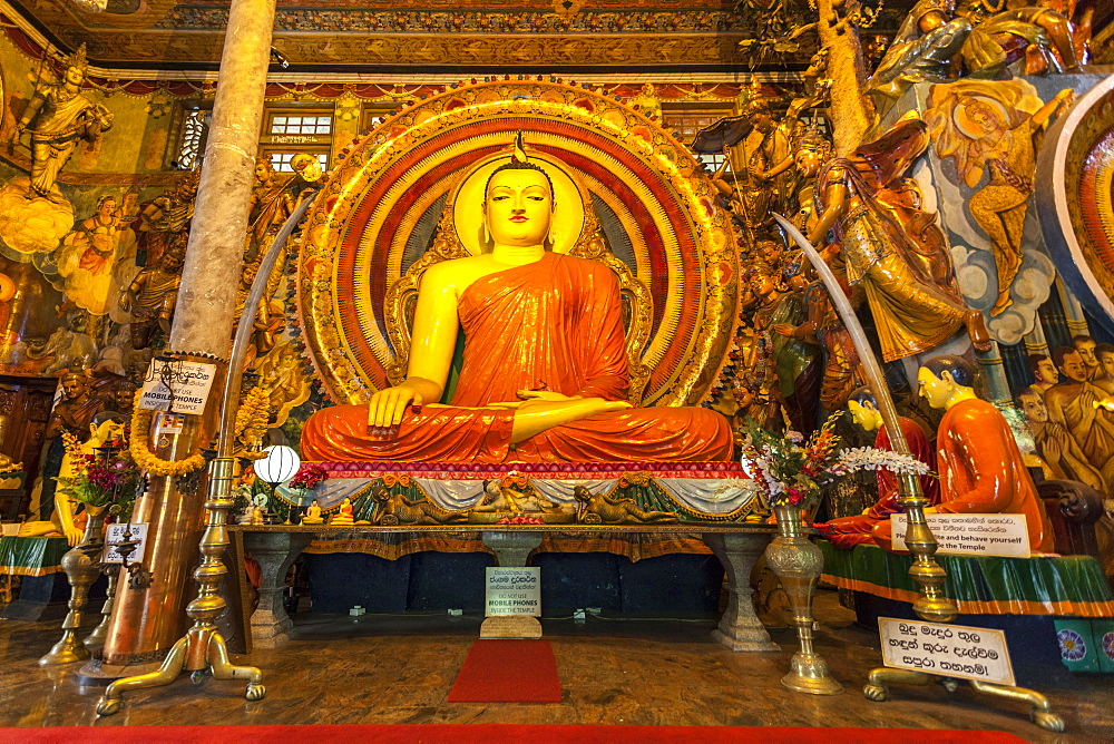 Large Buddhist statue at Gangaramaya Temple, Colombo, Sri Lanka, Asia
